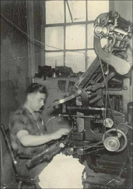 Arthur Sweetland operating the linotype machine at the Fishermen�s Advocat.