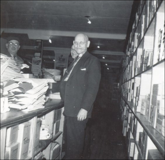 Zeb Russell, Joseph Parsons, and Alfred Hussey, in the dry goods department, Fishermen's Union Trading Company store.