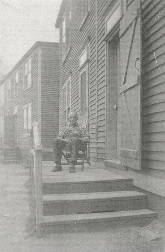 Isaac Russell on his front step.