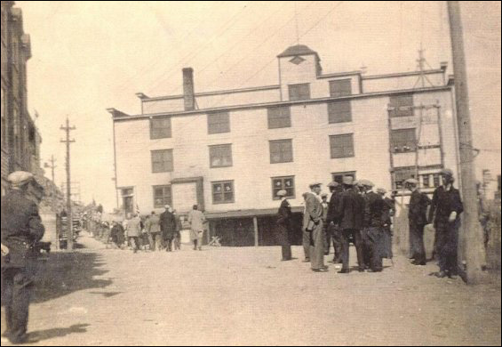 Parade day at Port Union with eastern facade of the Fishermen's Union Trading Company store in background.