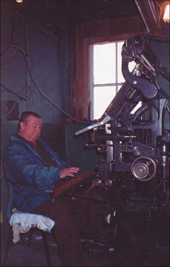 Arthur Sweetland at the linotype machine.