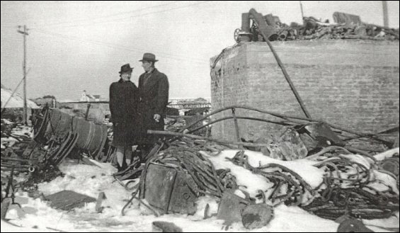 Morning after the fire of March 1945 which destroyed the Fishermen's Union Trading Company premises.