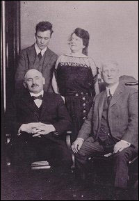 Sir William F. Coaker (bottom left) with three unidentified people.