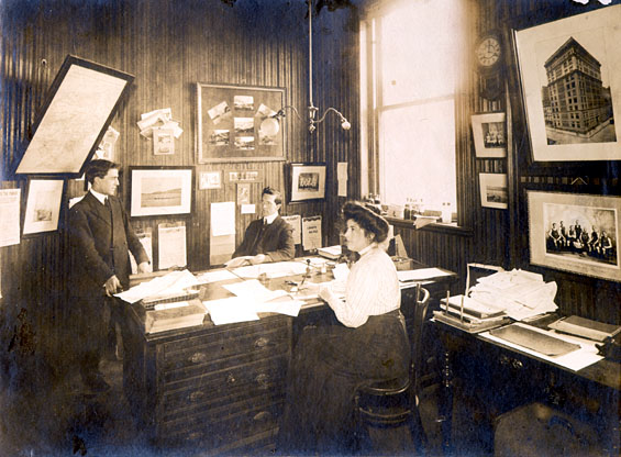 Three people in Job Brothers & Co. shipping office