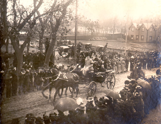 Duke and Duchess of York and Cornwall riding in a horse drawn carriage on Military Road, St. John's