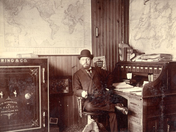 Mr. C. MacPherson, manager of Royal Stores, in his office