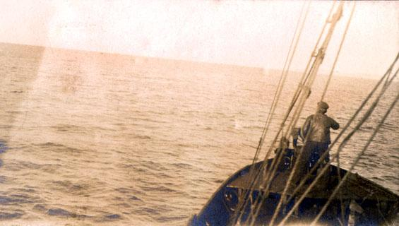 Man standing in the bow of a vessel hunting whales