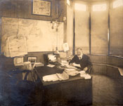 Mr. G.A. Hutchings sitting at his desk