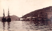 View of Job Brothers & Co. south side premises, St. John's taken from the harbour with two vessels in the foreground