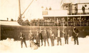 "Group of helpers from Horse Island standing by the S.S. ""Sagona"""