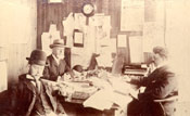 Robert Brown Job, Thomas Raffles Job and William Carson Job in an office at Job Brothers & Co.