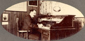 Mr. A. MacPherson at his desk