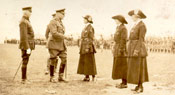 Sir Douglas Haig greeting three women at the inspection of the troops, headquarters of the Great War Veterans Association