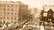 View of the crowd on Water St., St. John's, looking West from the War Memorial