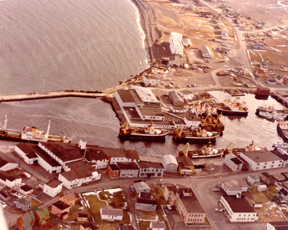 Aerial view of Grand Bank, Newfoundland, showing Water Street, Bonavista Cold Storage Co. Ltd. plant and trawlers