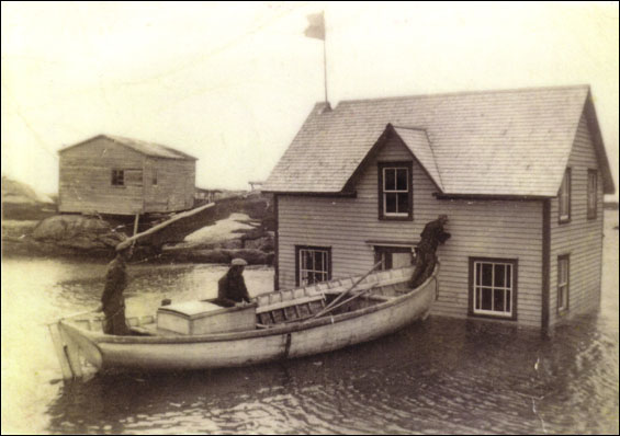 Cape Island, house of Walt Andrews, floating house across Inner Tickle of Newtown after being purchased in Newtown,  1952