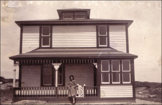 Minnie Feltham in front of a house built by Bert Feltham but never lived in. Later taken down to build a 'store'