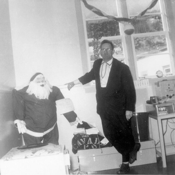 Walter Ingram with Santa at Harbour Buffett, Placentia Bay.