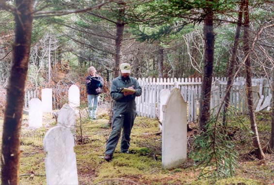 Donna (Tulk) Morash and Ken Tulk recording cemetary inscriptions at Harbour Buffett, Placentia Bay.