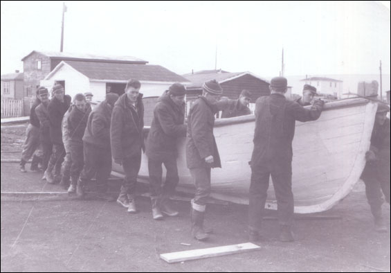 Men moving a boat