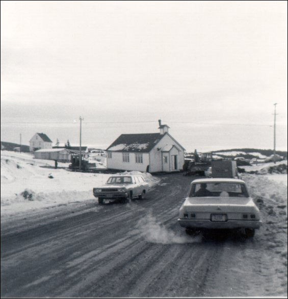 The Church of St. Mary the Virgin, moved from St. Joseph's to Marystown, being towed up the road