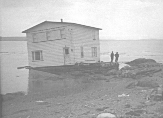 George and Alice Eastman house, North Harbour, Placentia Bay on the barge that brought it from Woody Island