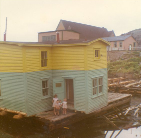 Jack Wadman house on a barge ready to move from Bar Haven to Southern Harbour, Placentia Bay