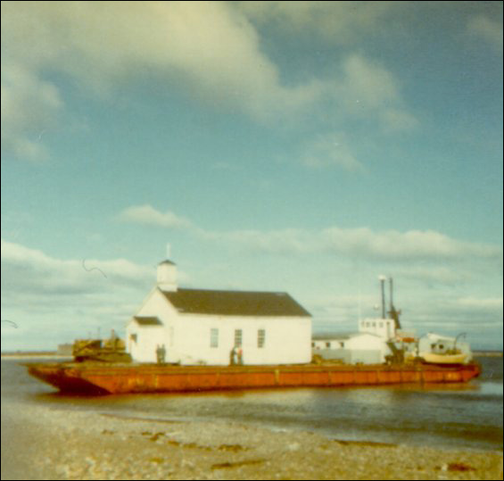 Anglican Church, Point Rosie, on the barge being moved to Frenchman's Cove, Fortune Bay