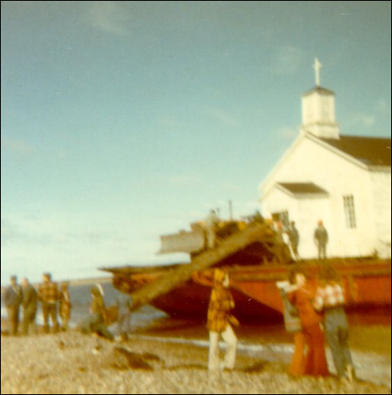 Anglican Church, Point Rosie on the barge being moved to Frenchman's Cove, Fortune Bay