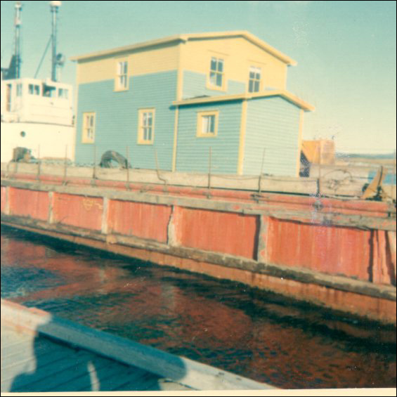 Charles Holly house on the government barge tied up at Garnish after being towed from Point Rosie