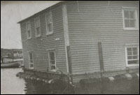 House of Albert Cluett, Sr. being moved<br>from Cape Cove to Tilting, June 1959