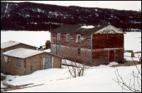 Llewellyn Randell's stage and store, Bide Arm [Buildings were floated from Hooping Harbour to Bide Arm in 1969.]