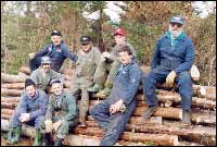 Leeland Masters, Roy Wareham (2nd & 3rd, in front) and friends cutting sticks to build a wharf for the reunion at Harbour Buffett.