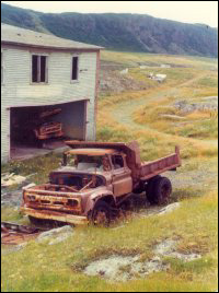 Council building and abandoned council trucks, Merasheen