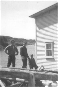 George and Alice Eastman house, North Harbour, Placentia Bay, on the barge that brought it from Woody Island, Placentia Bay