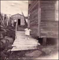 House and shed of Wilfred Budgell, (pictured) Joseph Budgell, Wild Cove